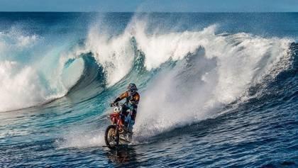 Robbie Maddison rides a wave